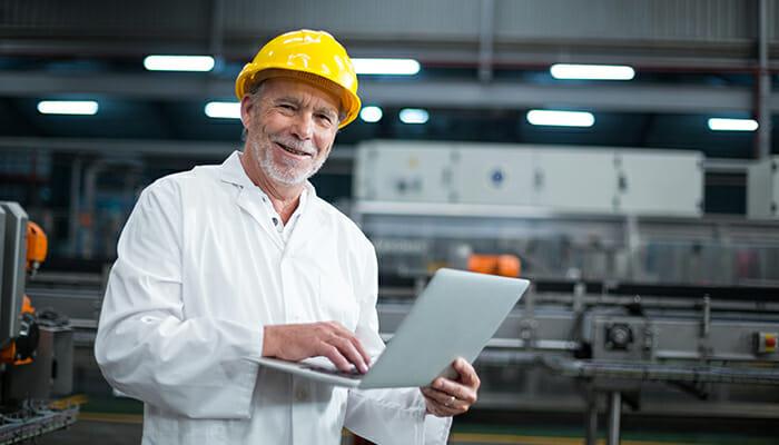 A man wearing hard hat smiling