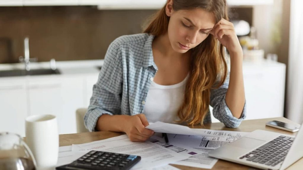 a woman researching options for cpq software solutions