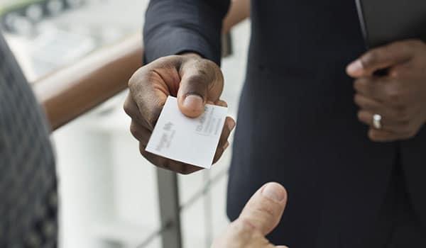 a businessman handing a business card